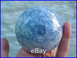 Blue calcite crystal sphere ball 718g 70 mms throat chakra