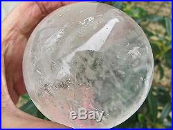 LARGE CLEAR QUARTZ CRYSTAL BALL OR SPHERE 970g 8CMS 80 MMS WITH INCLUSIONS